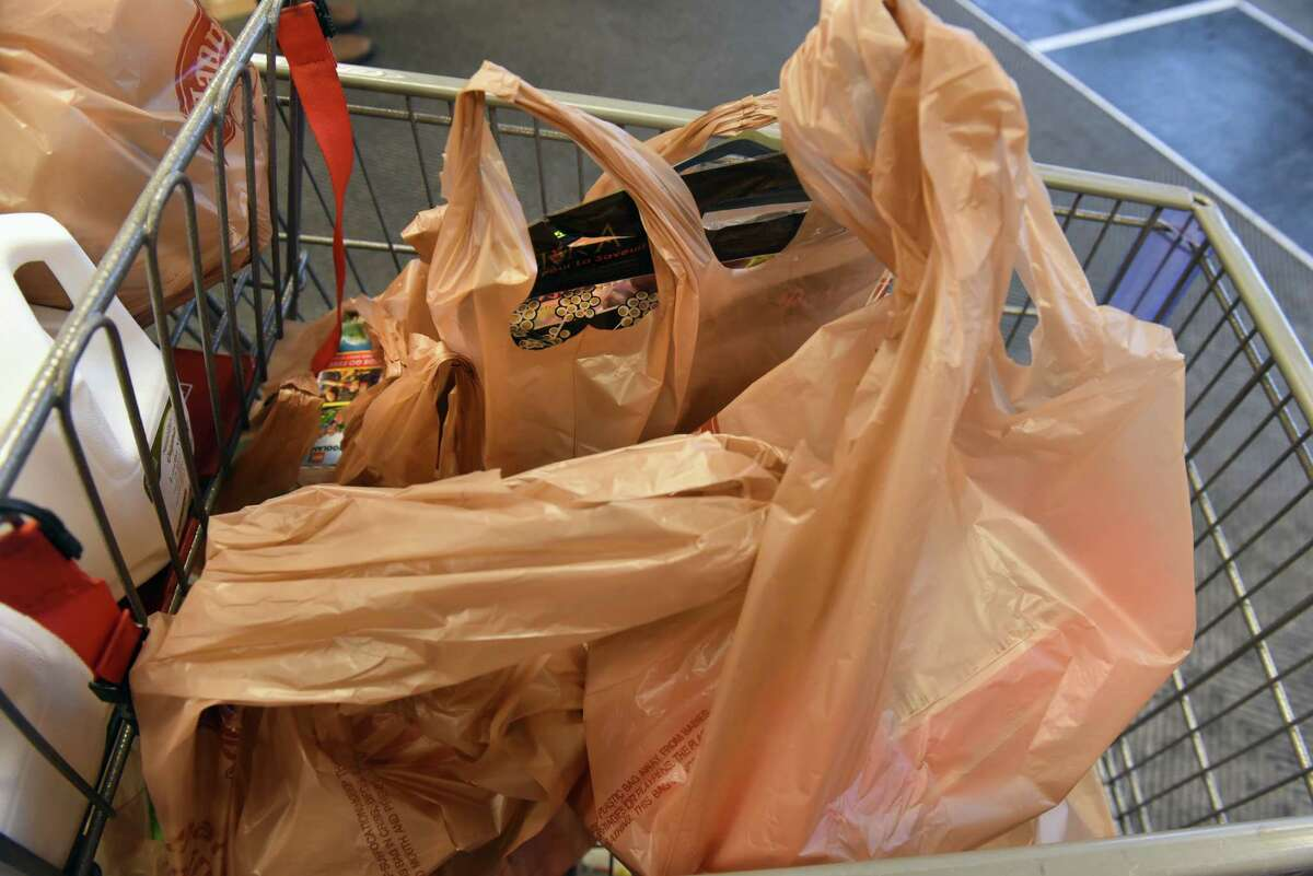 Amid concerns about the virus and the safety of reusable bags, supermarkets across the Capital Region and New York state are once again giving customers single-use plastic bags for their groceries.