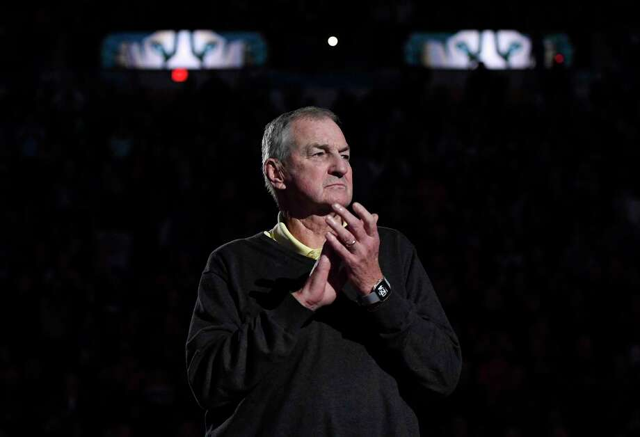 Former UConn head coach Jim Calhoun claps during a special halftime ceremony honoring the 1999 national championship team on Sunday in Hartford. Photo: Jessica Hill / Associated Press / Copyright 2019 The Associated Press. All rights reserved