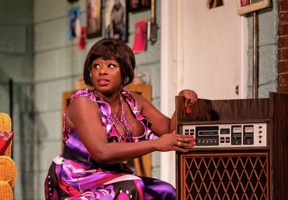 Nyahalie Allie tends to the music in the play. Photo: T. Charles Erickson / Contributed Photo