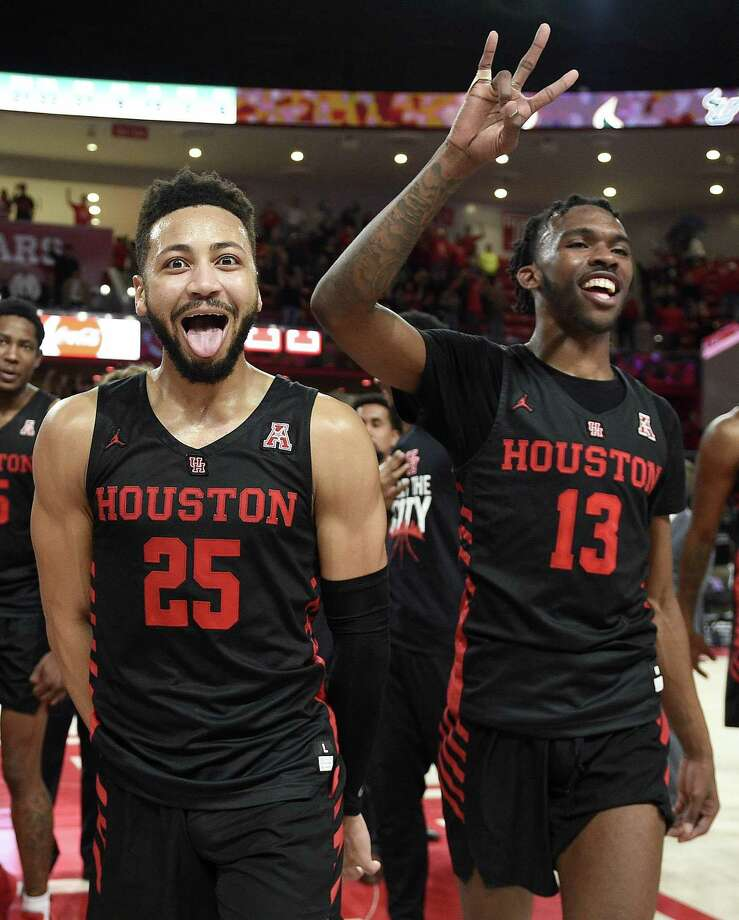 Houston guard Galen Robinson Jr. (25) and Dejon Jarreau (13) walk off the court after Saturday's win over USF. Photo: Houston Chronicle
