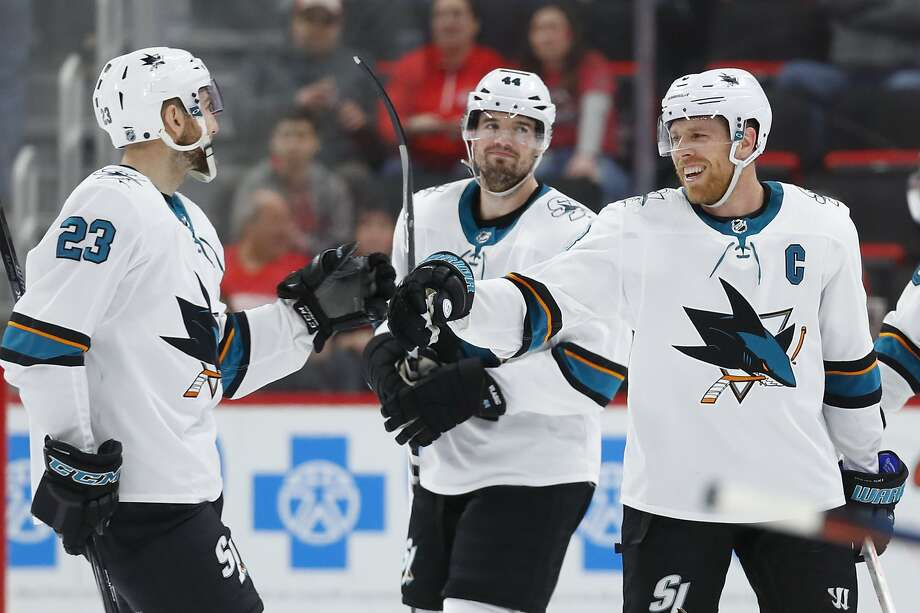 San Jose Sharks center Joe Pavelski, right, celebrates his empty net goal with Barclay Goodrow (23) in the third period of an NHL hockey game against the Detroit Red Wings, Sunday, Feb. 24, 2019, in Detroit. Pavelski scored three goals in the Sharks' 5-3 win. (AP Photo/Paul Sancya) Photo: Paul Sancya / Associated Press