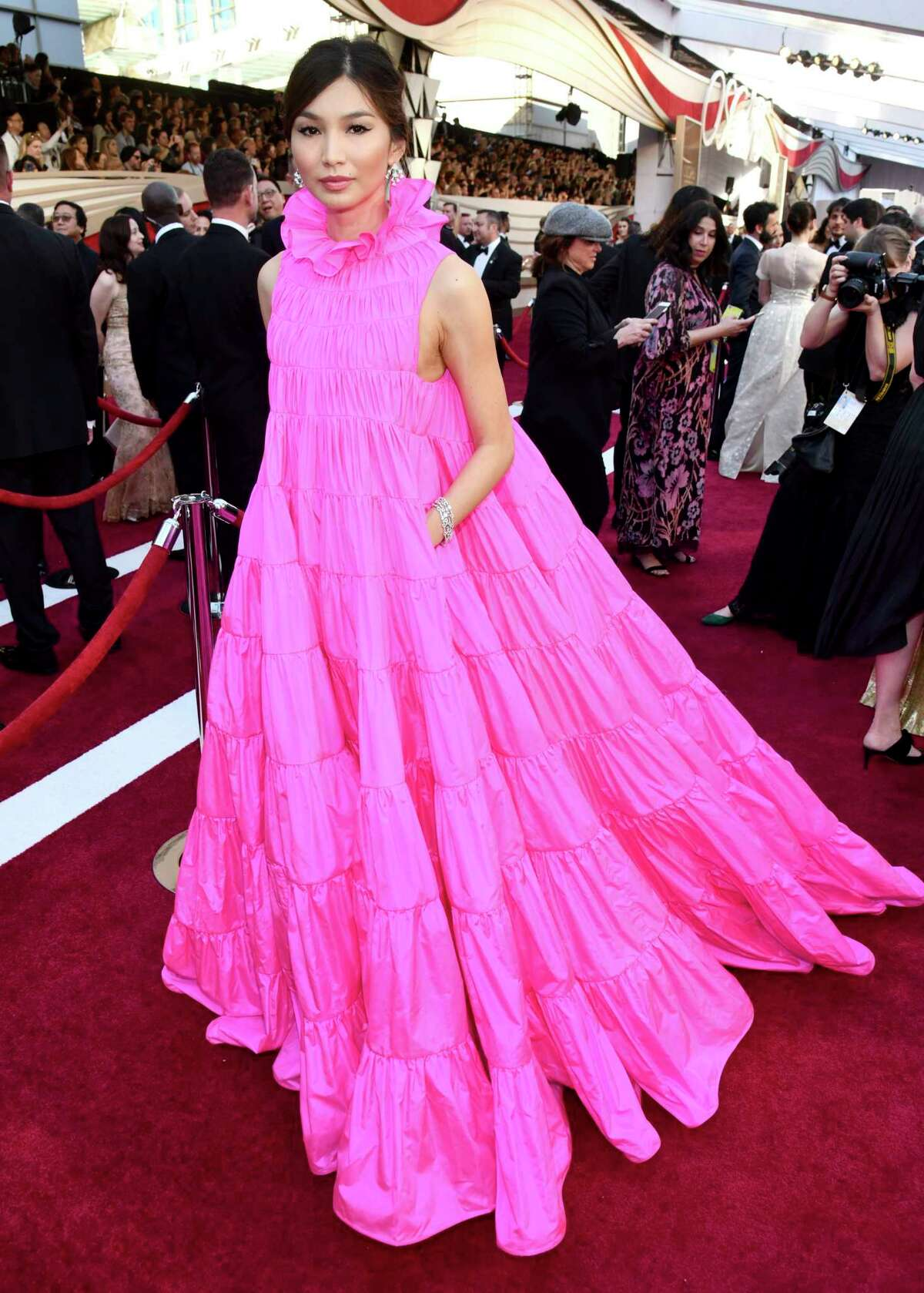 BEST: Gemma Chan flowed across the red carpet in a Valentino tiered dress with a ruffle collar and pockets.