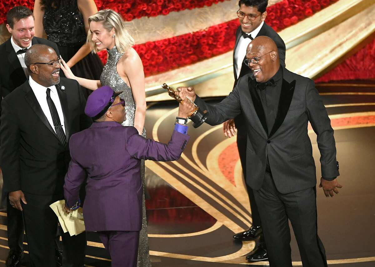 Spike Lee accepts the Adapted Screenplay award for 'BlacKkKlansman' from Samuel L. Jackson onstage during the 91st Annual Academy Awards at Dolby Theatre on February 24, 2019 in Hollywood, California.