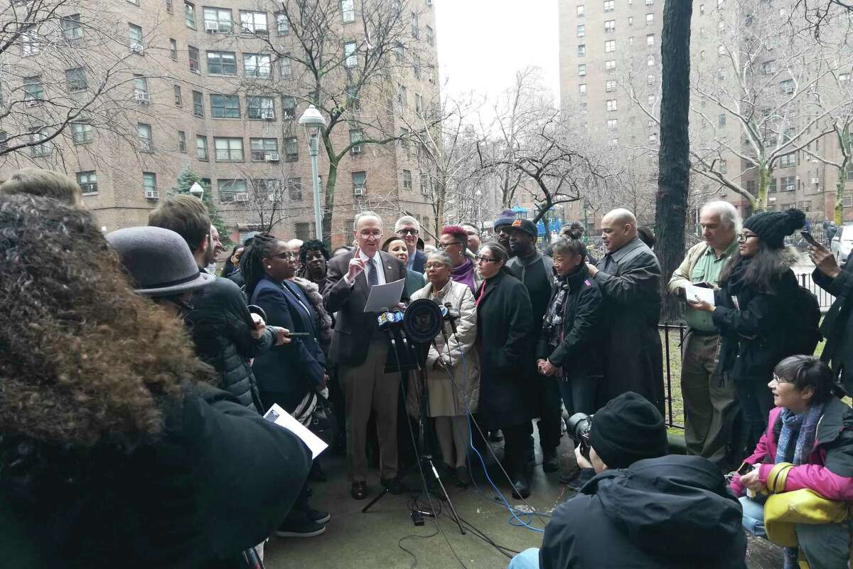 Senate Minority Leader Charles Schumer, D-N.Y. gestures while speaking during a news conference at the Alfred E. Smith houses Sunday, Feb. 24, 2019, in New York. Schumer on Sunday demanded that the Trump administration earmark at least $1.2 billion in the federal budget for New York City's blighted public housing ? the nation's largest. (AP Photo/Julie Walker)