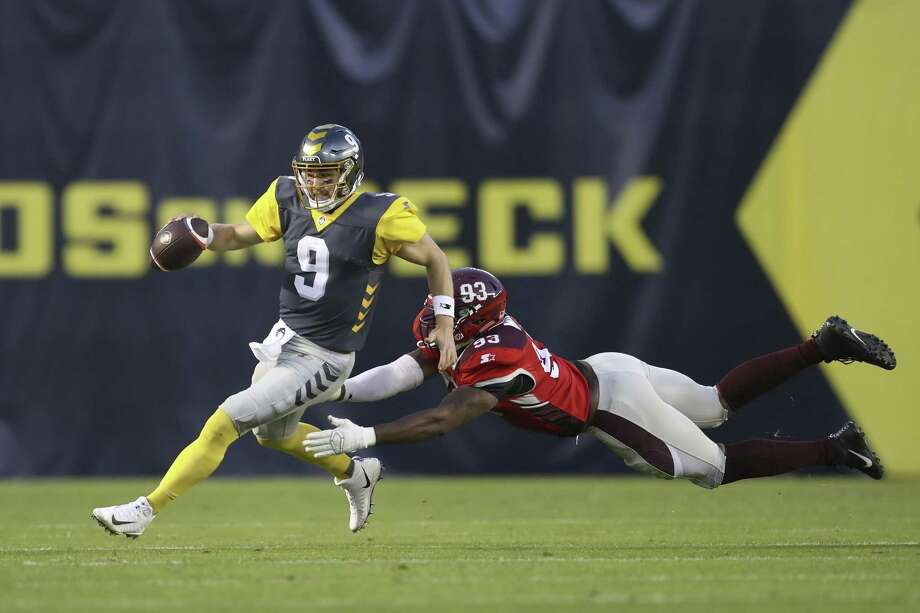 San Antonio Commanders defensive lineman Arthur Miley (93) makes a diving tackle attempt at San Diego Fleet quarterback Phillip Nelson (9) in the first half during a San Antonio Commanders at San Diego Fleet AAF football game, Sunday, Feb. 24, 2019, at SDCCU Stadium in San Diego. (AP Photo/Peter Joneleit) Photo: Peter Joneleit, FRE / Associated Press / Copyright 2019 The Associated Press. All rights reserved.