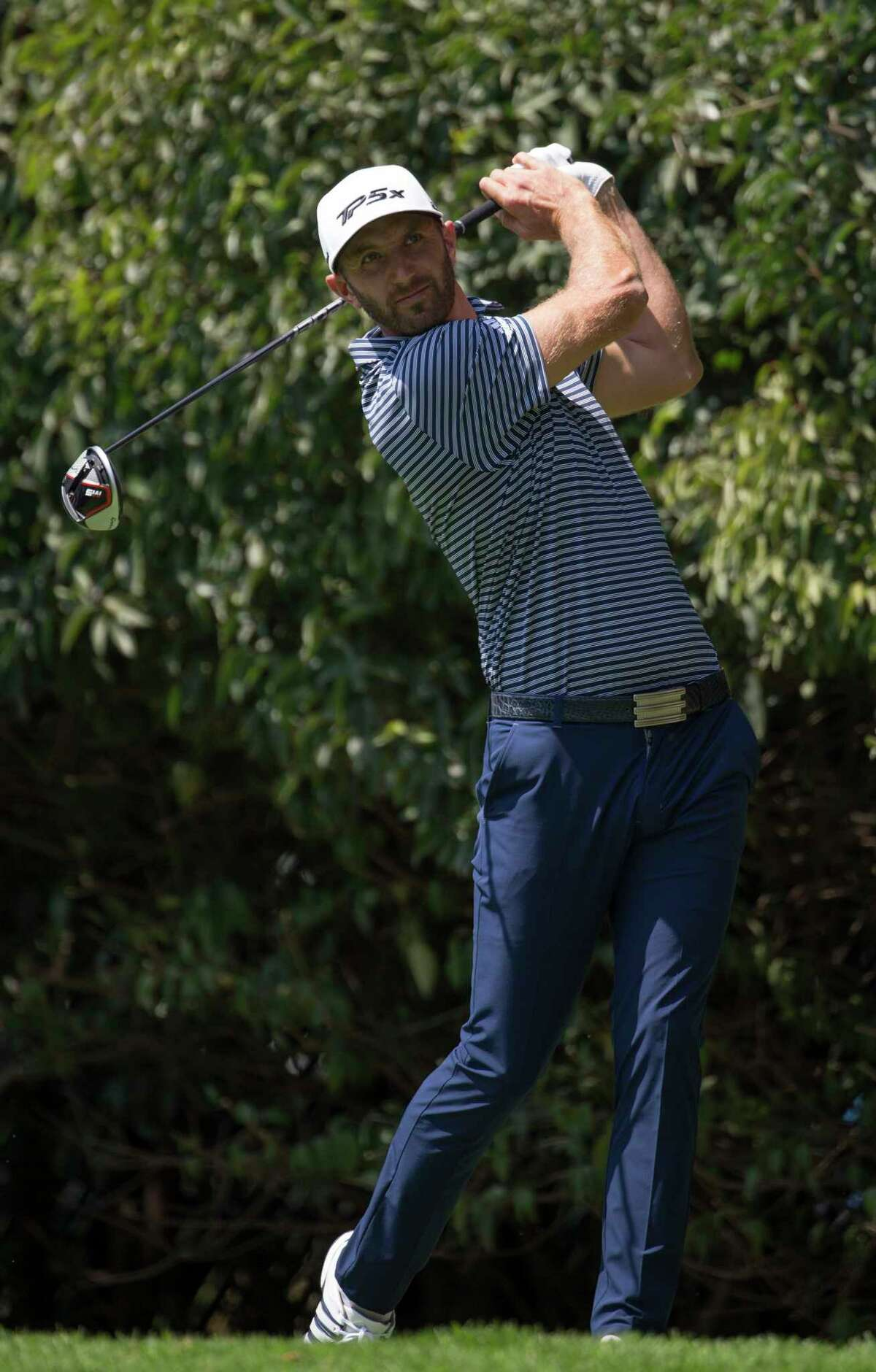 U.S. golfer Dustin Johnson watches his ball in the second hole during the WGC-Mexico Championship at the Chapultepec Golf Club in Mexico City, Sunday, Feb. 24, 2019. (AP Photo/Christian Palma)