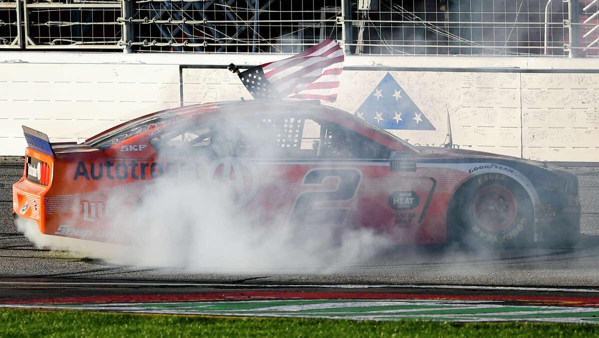 Brad Keselowski does a burnout after winning a Monster Energy NASCAR Cup Series auto race at Atlanta Motor Speedway, Sunday, Feb. 24, 2019, in Hampton, Ga. (AP Photo/John Amis)