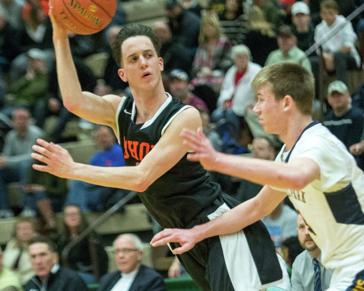 Mohonasen?s Duncan Tallman makes a pass in front of an Averill Park defender during the Section II, Class A quarterfinals at Hudson Valley Community College on Sunday, Feb. 24, 2019. (Jim Franco/Special to the Times Union)
