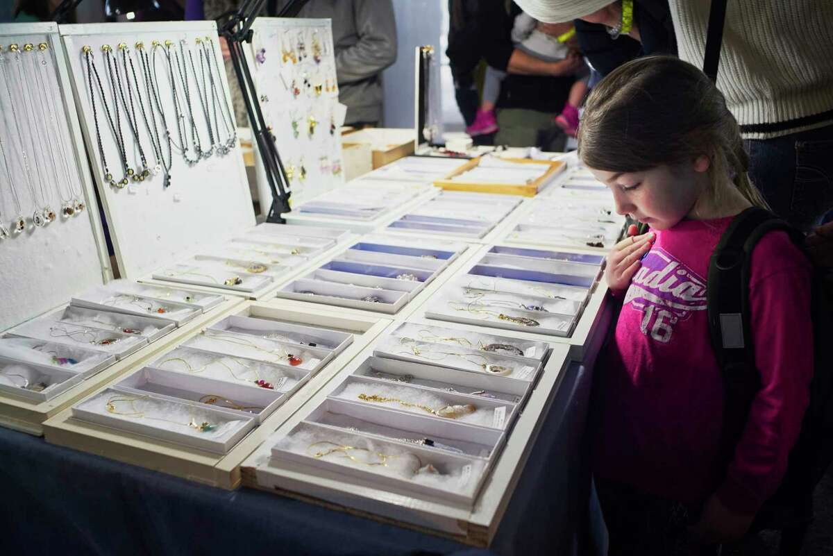 Abigail Szinger, 5, looks over mineral necklaces to find the one she wants to buy at the 26th Annual James Campbell Memorial Gem, Mineral, and Fossil Show and Sale at the New York State Museum on Sunday, Feb. 24, 2019, in Albany, N.Y. Thirty vendors from mostly the Northeast took part in the two-day show, which is co-sponsored by the Capital District Mineral Club and the New York Academy of Mineralogy. All proceeds from the event benefit the museumOs mineral-acquisition fund. (Paul Buckowski/Times Union)