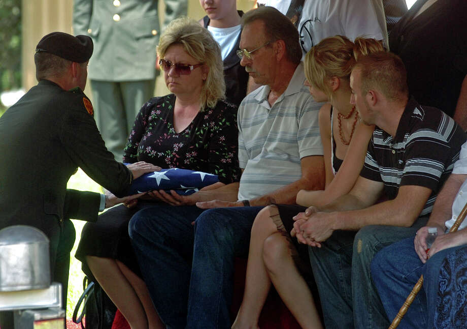 Jane and Jerry Block are presented with the U.S. flag during the funeral services for their daughter, U.S. Army Spc. Kamisha Jane Block, at Del-Rose Cemetery in Vidor on Thursday, Aug. 23, 2007.   Mark M. Hancock / The Beaumont Enterprise Photo: Mark M. Hancock/The Beaumont Enterprise / The Beaumont Enterprise