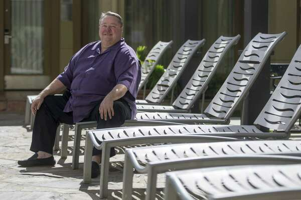 McClure, shown at another of his hotels, DoubleTree by Hilton Hotel, says he was able to bring back employees with a loan from the Payment Protection Program.