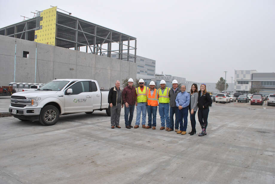 KDW, a Houston-based design/build firm, topped out or reached final construction height on and expansion of Accredo Packaging's Sugar Land campus. Photo: KDW