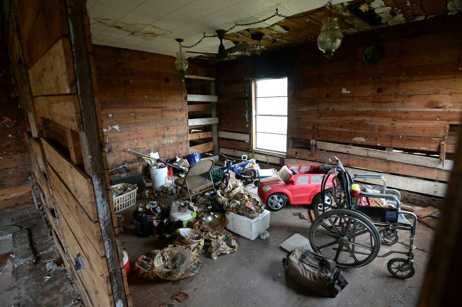 The front room at Havalisia Owens' Port Arthur home a year and a half after Tropical Storm Harvey flooded it. Owens said she tried to repair the home, but was unable to secure funding.  Photo taken Wednesday, 2/20/19 Photo: Guiseppe Barranco/The Enterprise