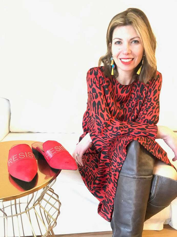 """Marina Levine of Greenwich is one of the co-founders of Indivisible Greenwich, and she has launched a line of conversation-starting footwear. IamMoi is a direct-to-consumer line featuring sleek, leather slides and loafers bearing resistance slogans, such as """"Resist,"""" """"We Rise"""" and """"Vote."""" Photo: Contributed /"""