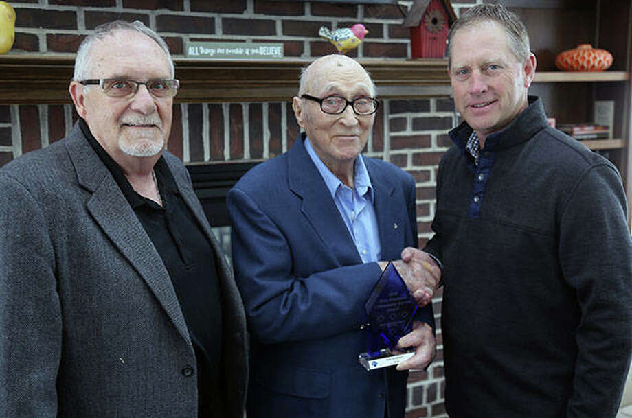 Keith Bradbury (left), brother of the late Ken Bradbury, and Elmer Bradbury, his father, receive a Blue Diamond Community Service Award from First National Bank of Arenzville President Kai Schnitker. Photo: Photo Provided
