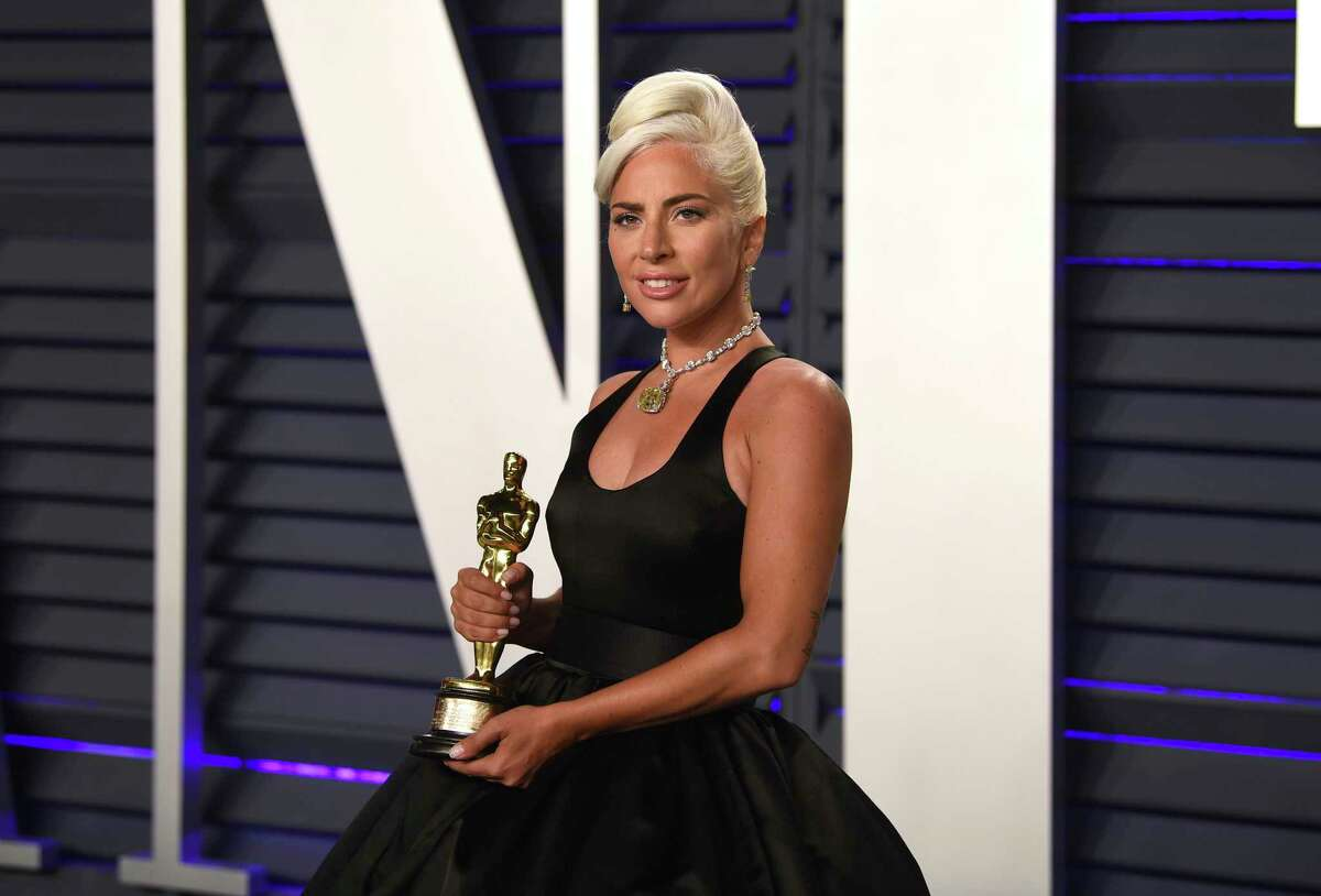 """Lady Gaga, winner of the award for best orginial song """"Shallow,"""" arrives at the Vanity Fair Oscar Party on Sunday, Feb. 24, 2019, in Beverly Hills, Calif. (Photo by Evan Agostini/Invision/AP)"""