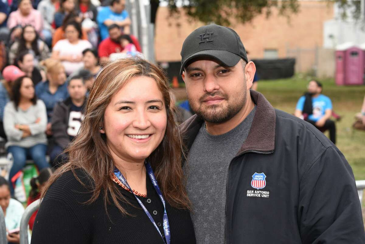 Aimee Hernandez and Kike Rendon pose for a photo during the Washington Birthday Parade.