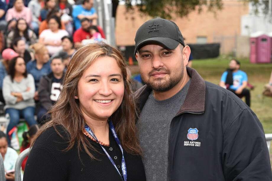 Aimee Hernandez and Kike Rendon pose for a photo during the Washington Birthday Parade. Photo: Christian Alejandro Ocampo