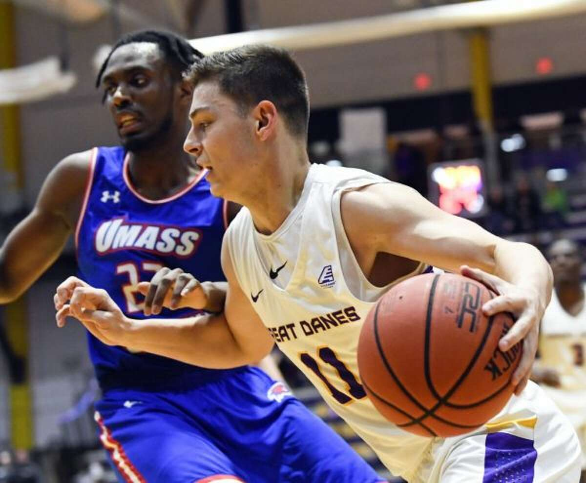 University of Massachusetts guard Christian Lutete (23) defends against University at Albany guard Cameron Healy (11) during the first half of an NCAA men's college basketball game Wednesday, Feb. 13, 2019, in Albany, N.Y. (Hans Pennink / Special to the Times Union)