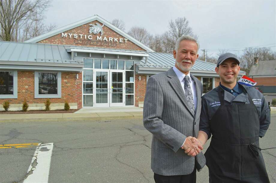 Father and son, David Griswold senior and junior outside their new Mystic Market kitchen & eatery, which opened on Monday, Feb. 25, 2019, in Westport, Conn. Photo: Jarret Liotta / For Hearst Connecticut Media / Westport News Freelance