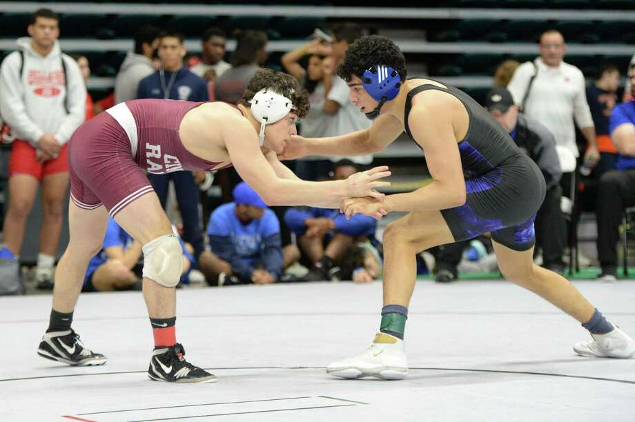 Daniel Hernandez-Mendoza of Westside and Ethan Reyes of Cinco Ranch compete in the boys 138 pound weight class during the Region III 6-A UIL Wrestling Championships on Saturday February 16, 2019 at the Merrell Center, Katy, TX. Photo: Craig Moseley, Houston Chronicle / Staff Photographer / ©2019 Houston Chronicle