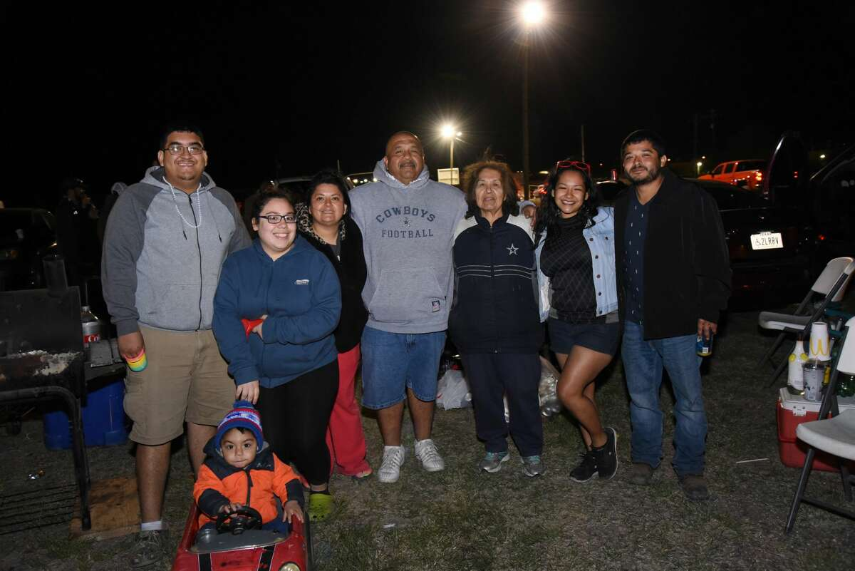 Attendees pose for a photo during the HEB Firework Extravaganza.