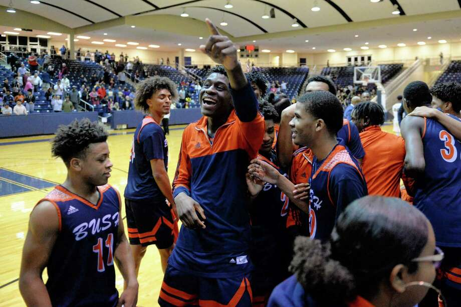 The Fort Bend Broncos celebrate their 52-46 victory over the Spring Woods Tigers in a Class 6A, Region III area-round basketball playoff game on Friday, at Coleman Coliseum, Houston, TX. Photo: Craig Moseley, Houston Chronicle / Staff Photographer / ©2019 Houston Chronicle