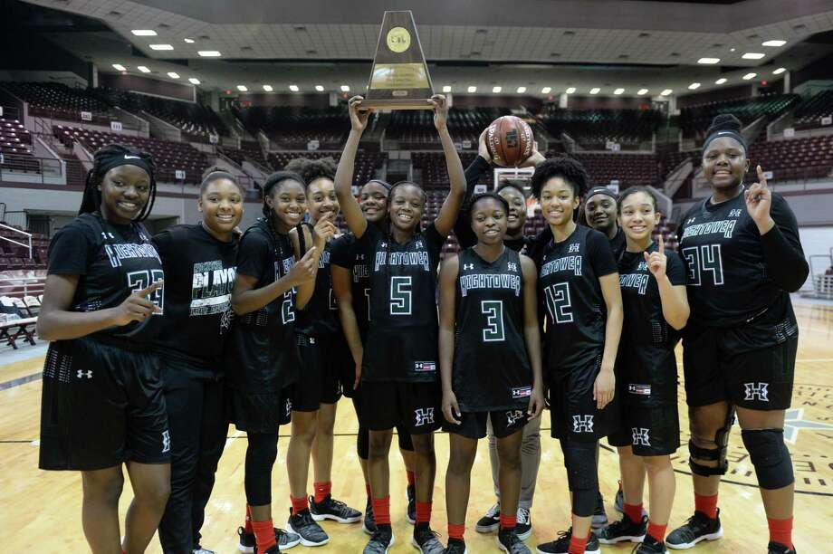 The Hightower Hurricanes pose following their 47-39 victory over the Manvel Mavericks in the Class 5A, Region III final basketball playoff game on Saturday, at the Campbell Center, Houston, TX. Photo: Craig Moseley, Houston Chronicle / Staff Photographer / ©2019 Houston Chronicle