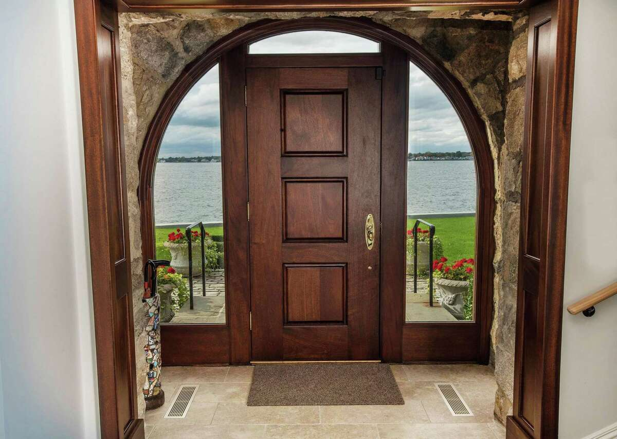 The home is designed with definitive circular arches framing doorways and windows.