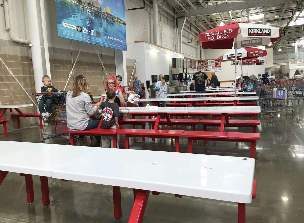 Customers eat in Costco's food court