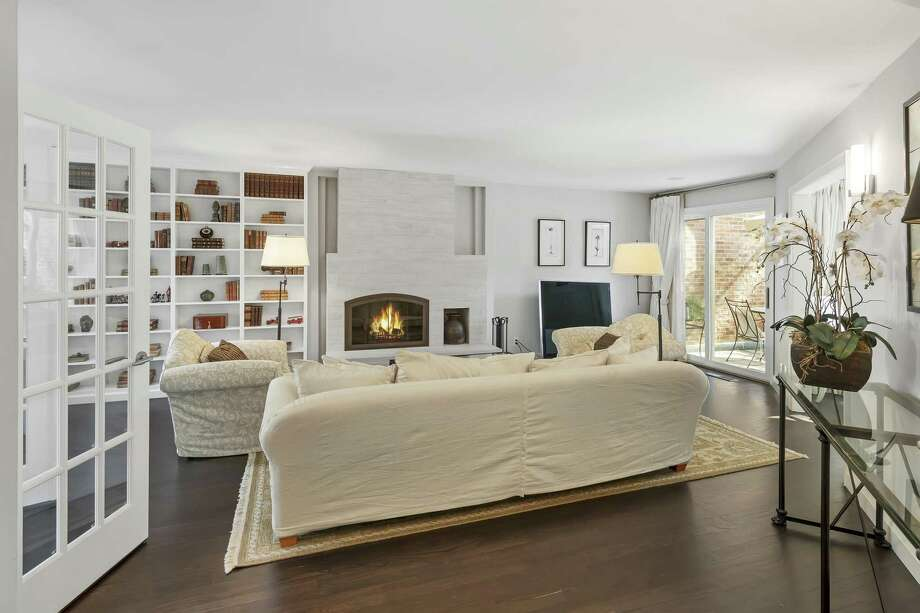 The living room fireplace at 101 Lewis St., Unit B, was rebuilt. Photo: Sotheby's International Realty / ONLINE_CHECK