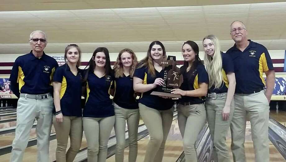 Members of the Bad Axe girls bowling team pose after winning the Division 4 regional championship, Friday, at Bay Lanes, in Bay City. (Courtesy Photo)