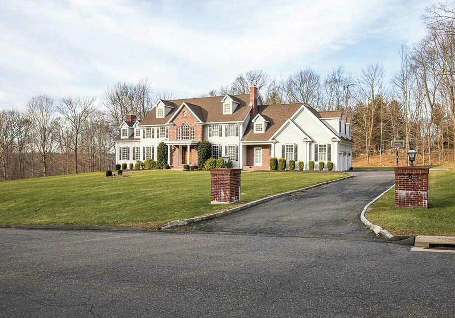 Built in 2004, the colonial at 3 Elderslie Lane in Woodbridge is ocated on 1.49 acres and the exterior was freshly painted in 2017. Photo: Real Living Wareck D'Ostilio / ONLINE_CHECK