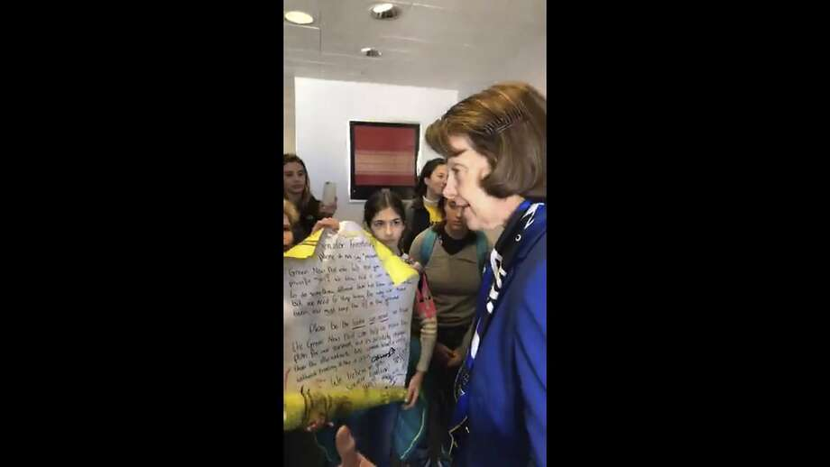 In this image from video provided by Morissa Zuckerman, U.S. Sen. Dianne Feinstein, D-Calif., speaks with a group of students who wanted to discuss the Green New Deal, an ambitious Democrat plan to shift the U.S. economy from fossil fuels and to renewable sources such as wind and solar power, at her office in San Francisco. The students are members of Sunrise Movement, an activist group that encourages children to combat climate change. (Morissa Zuckerman via AP) Photo: Morissa Zuckerman / Associated Press