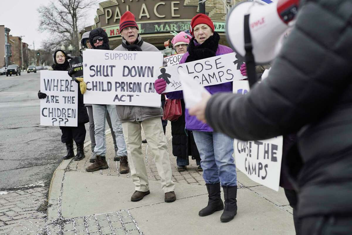 Protestors gather outside the Leo O'Brien Federal Building on Monday, Feb. 25, 2019, in Albany, N.Y. The women and men attending the protest were calling on Senator Charles Schumer and Senator Kirsten Gillibrand to support a bill to shut down detention centers holding migrant children who crossed the border. (Paul Buckowski/Times Union)