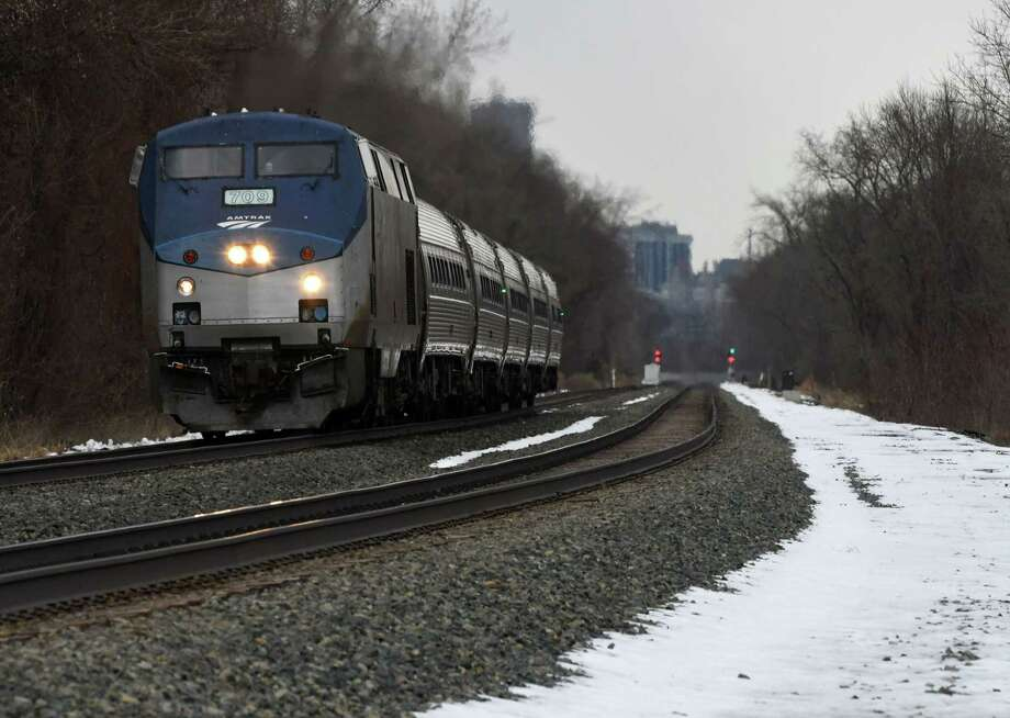 A New York-bound Amtrak train heads south past Staats Island Road on Monday Feb. 25, 2019, in Schodack, N.Y. (Will Waldron/Times Union) Photo: Will Waldron, Albany Times Union / 40046277A