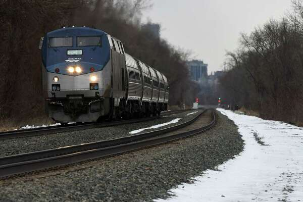 A New York-bound Amtrak train heads south past Staats Island Road on Monday Feb. 25, 2019, in Schodack, N.Y. (Will Waldron/Times Union)