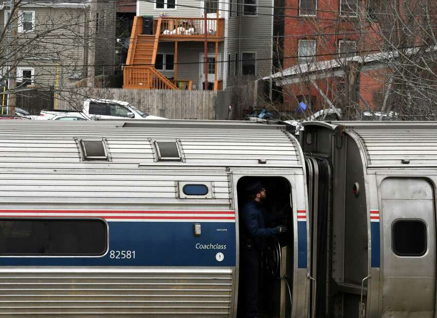 A train conductor stands in the doorway as a New York-bound Amtrak train pulls out of the Albany-Rensselaer train station on Monday Feb. 25, 2019, in Rensselaer, N.Y. (Will Waldron/Times Union)