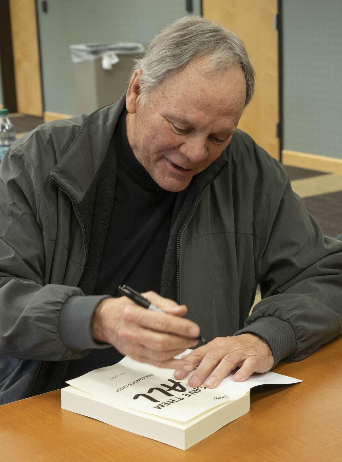 Former Midland College basketball coach Jerry Stone signs copies of his book, Save Them All: One Coach's Quest, 02/25/2019 before speaking at Midland College. Tim Fischer/Reporter-Telegram