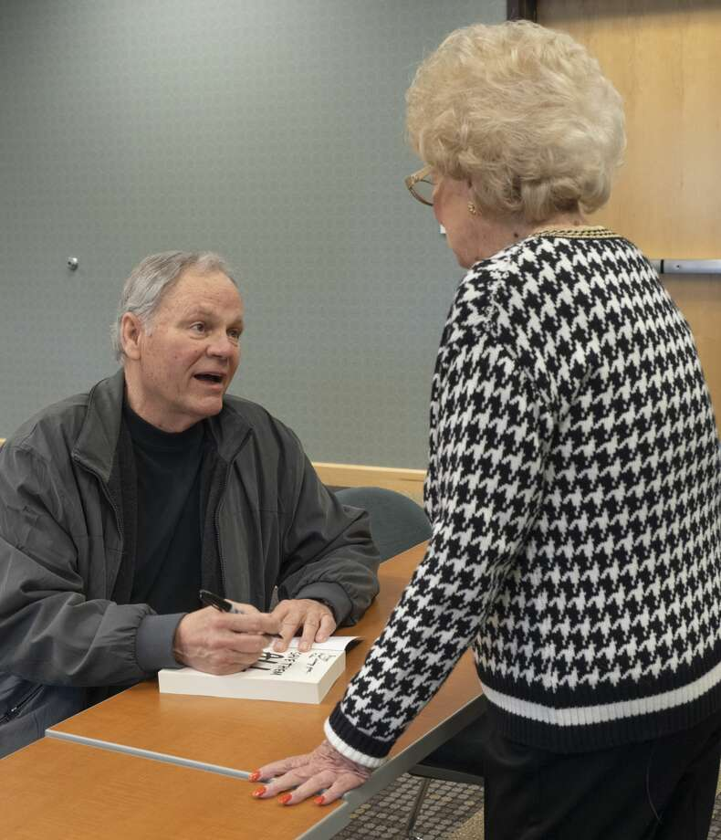 Former Midland College basketball coach Jerry Stone signs copies of his book, Save Them All: One Coach's Quest, for Peggy Williams 02/25/2019 before speaking at Midland College. Tim Fischer/Reporter-Telegram Photo: Tim Fischer