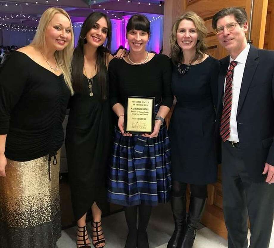 Madison County Animal Care and Control Manager Katherine Conder (center) stands with (left to right) Partner For Pets Senior Director Nevalea Fisher, Director Erika Pratte, Rita Prenzler and Chairman Kurt Prenzler after receiving the Newcomer Rescuer of the Year award during the Valen'tails Gala for Partners for Pets on Feb. 9 in Edwardsville. The award recognizes those who work hard and are new to helping save and rescue animals. Photo: For The Intelligencer