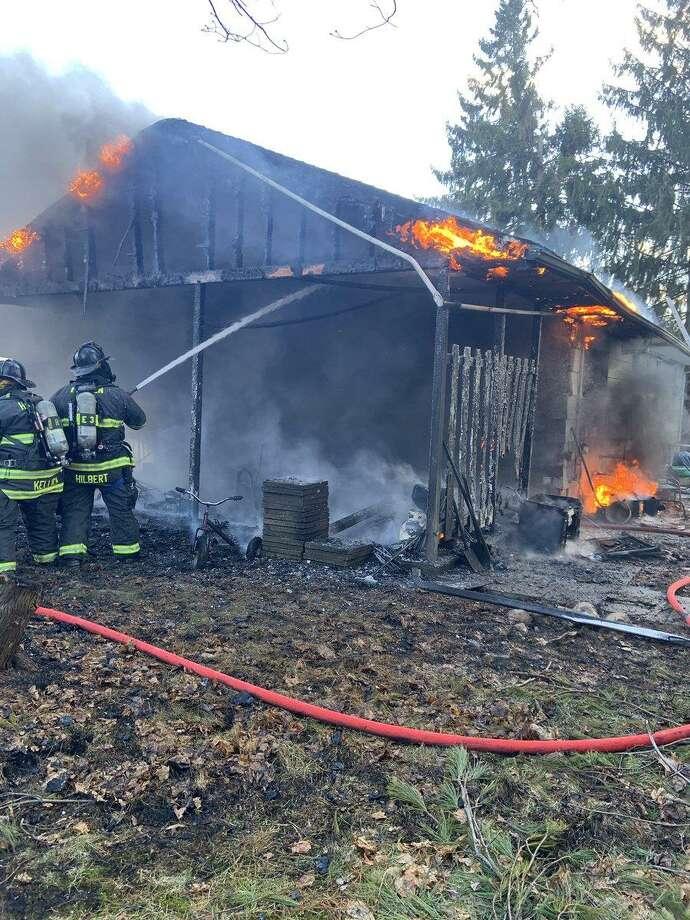 Hamden firefighters fight a fire at  a Fallon Drive home. Photo: Hamden Fire Department /
