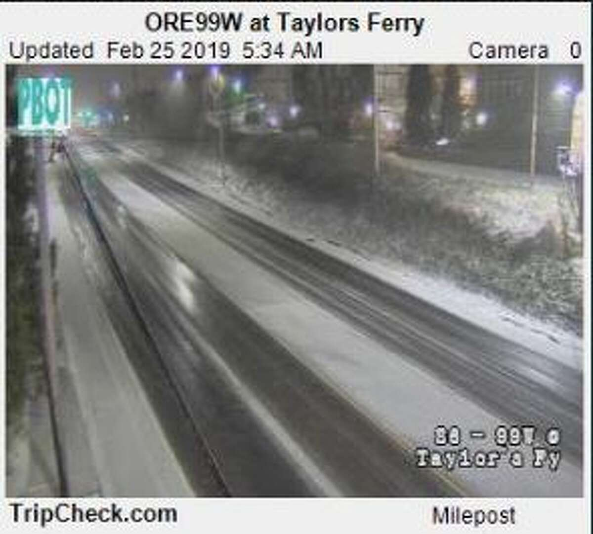 An Oregon Department of Transportation camera shows snow on the roads.