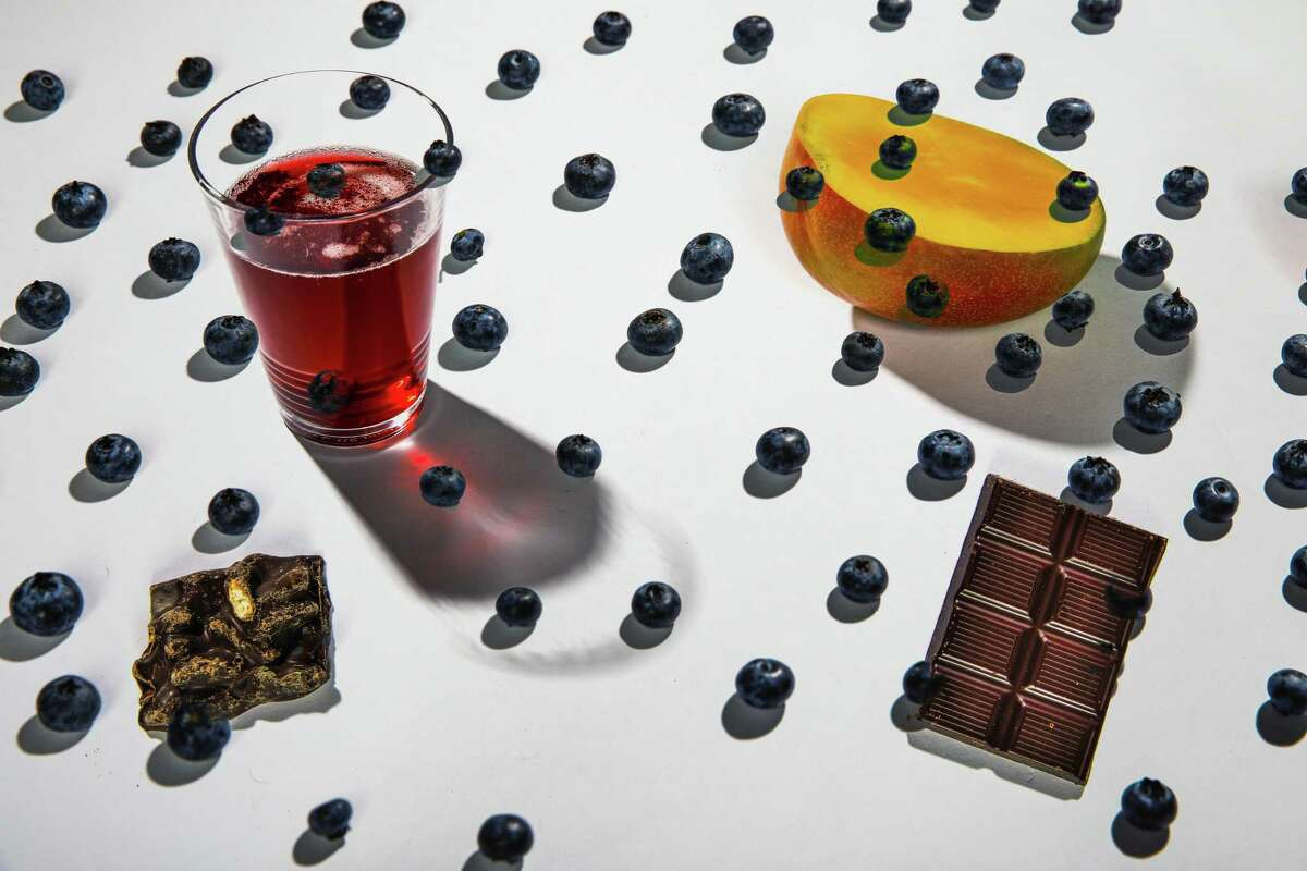 Blueberries, mango, chocolate and pomegranate juice are among foods with health benefits that should be re-examined.