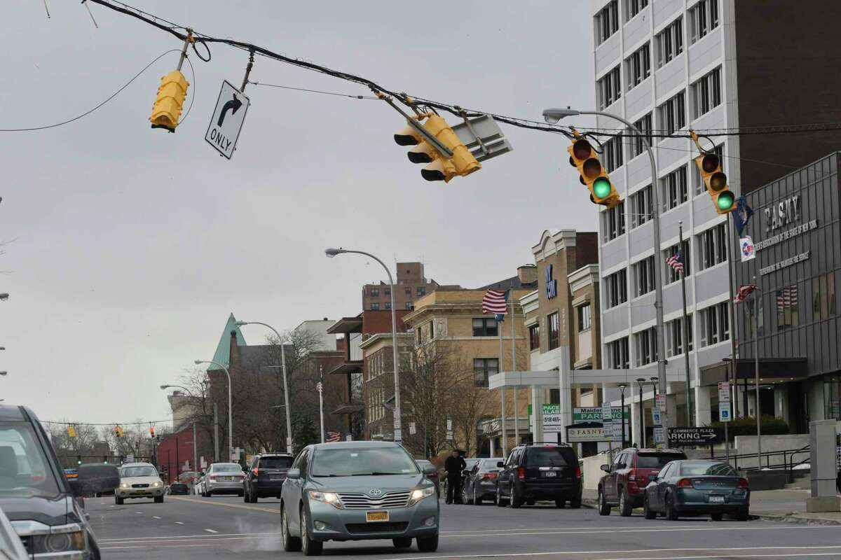 Traffic lights sway in the high winds along Washington Ave. on Monday, Feb. 25, 2019, in Albany, N.Y. (Paul Buckowski/Times Union)