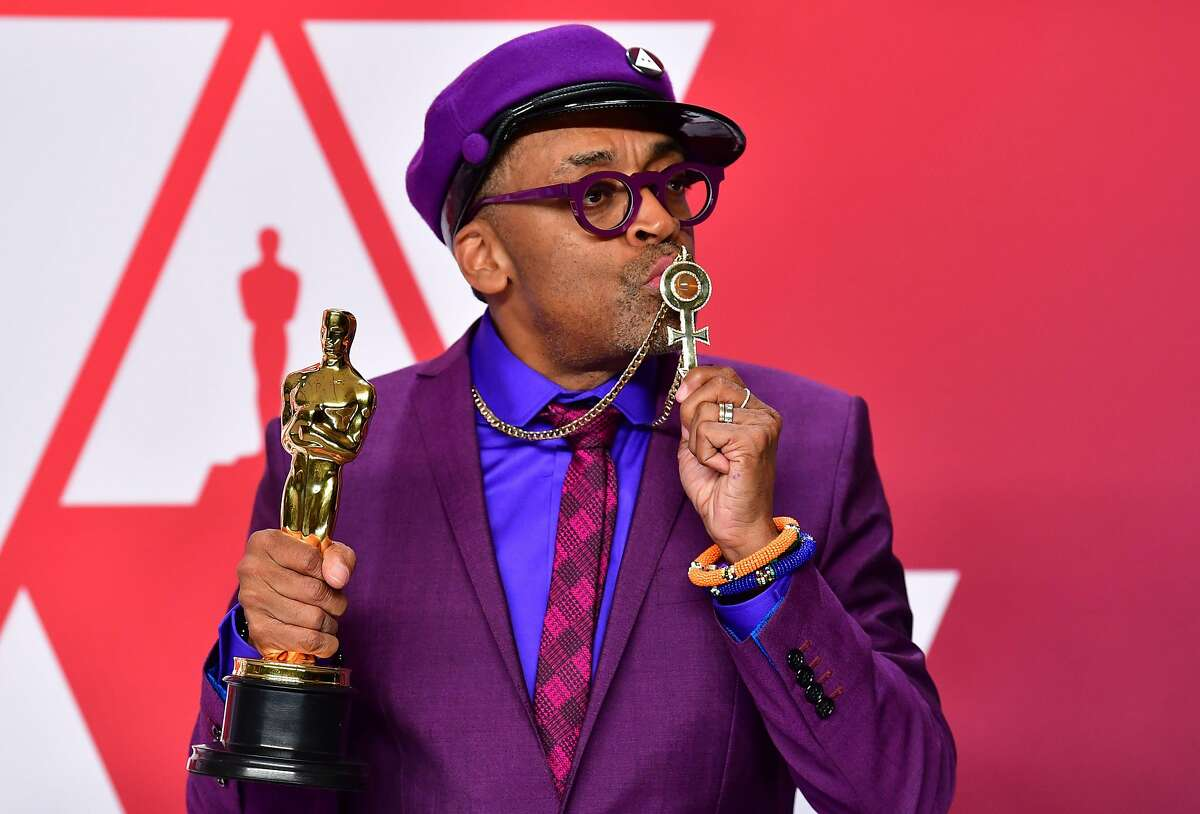 """(FILES) In this file photo taken on February 24, 2019 Best Adapted Screenplay winner for """"BlacKkKlansman"""" Spike Lee poses in the press room with the Oscar during the 91st Annual Academy Awards at the Dolby Theater in Hollywood, California. - US President Donald Trump on February 25, 2019 accused veteran film director Spike Lee of a """"racist hit"""" job after he won his first competitive Oscar and urged voters to mobilize for the next election. Lee took home a statuette for best adapted screenplay for """"BlacKkKlansman,"""" a stranger-than-fiction true story of an African-American police officer who managed to infiltrate the highest levels of the Ku Klux Klan. (Photo by FREDERIC J. BROWN / AFP)FREDERIC J. BROWN/AFP/Getty Images"""