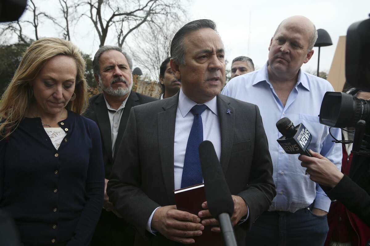 Holding a bible, former Texas State Senator Carlos Uresti talks with media before turning himself into authorities at the John H. Wood, Jr. U.S. Courthouse, Tuesday, Feb. 19, 2019.