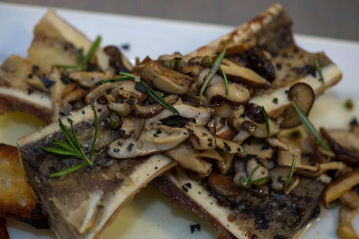 Roasted bone marrow with capers and mushrooms by chef Michael Jones during a pop-up dinner at Douglas Ranch in Carmel Valley, Calif.