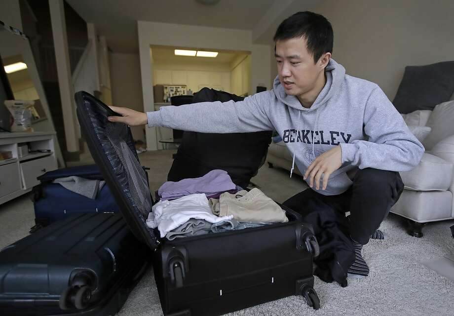 """In this Monday, Feb. 4, 2019, photo, Leo Wang packs a suitcase at his home in San Jose, Calif. Wang has found himself trapped in an obstacle course regarding H-1B work visas for foreigners. His visa denied and his days in the United States numbered, Wang is looking for work outside the country. """"I still believe in the American dream,"""" he says. """"It's just that I personally have to pursue it somewhere else."""" (AP Photo/Ben Margot) Photo: Ben Margot / Associated Press"""