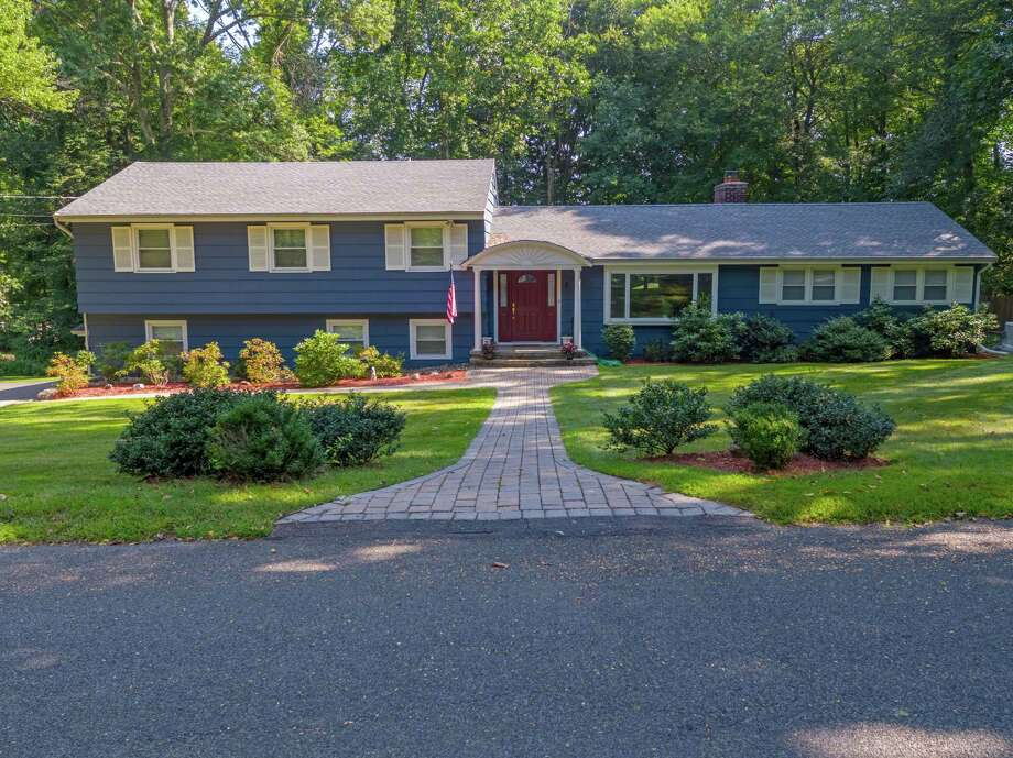 The ranch, split level house at 5 Wedgewood Drive sits on a 1.06-acre level property at the corner of Blanchard Road.